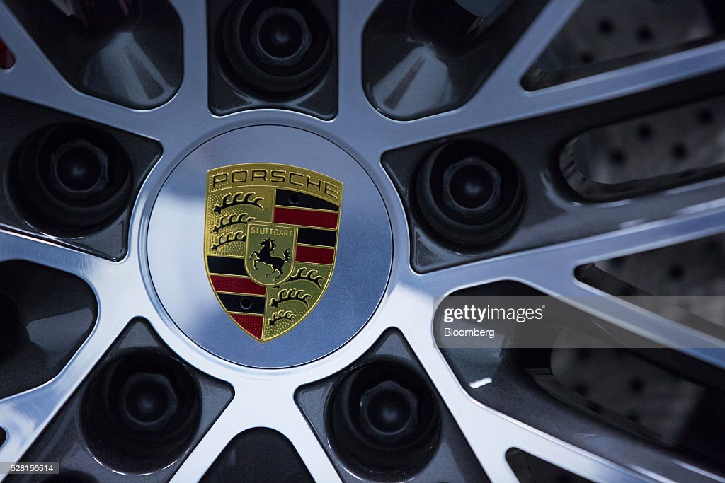 The Porsche badge sits on a wheel of a Porsche 718 Cayman luxury automobile during a quality control workshop at the automaker's headquarters in Stuttgart, Germany, on Wednesday, May 4, 2016. After the upscale Audi brand, Porsche is the second-largest earnings contributor at Volkswagen and generates the group's highest margins. Photographer: Krisztian Bocsi/Bloomberg via Getty Images