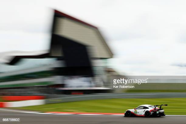 The Porsche GT Team 911 RSR of Michael Christensen and Kevin Estre drives during practice for the FIA World Endurance Championship at Silverstone on...
