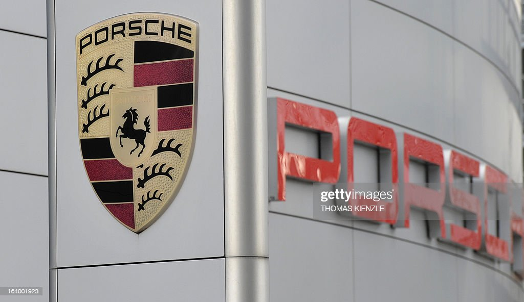 The Porsche logo is displayed in front of the Porsche museum in Stuttgart, southern Germany, on March 18, 2013, where the Porsche Automobile Holding SE will present the result of 2012 at the annual balance press conference. AFP PHOTO / THOMAS KIENZLE