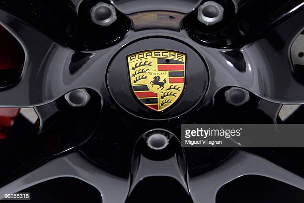 The Porsche logo is pictured during Porsche's annual general meeting on January 29 2010 in Stuttgart Germany German luxury cars maker merging with...