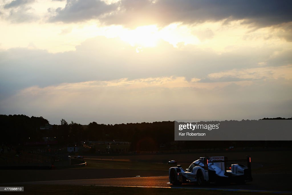 The Porsche Team 919 Hybrid of Earl Bamber, <a gi-track='captionPersonalityLinkClicked' href=/galleries/search?phrase=Nick+Tandy&family=editorial&specificpeople=7855517 ng-click='$event.stopPropagation()'>Nick Tandy</a> and Nico Hulkenburg drives at sunrise during the Le Mans 24 Hour race at the Circuit de la Sarthe on June 14, 2015 in Le Mans, France.