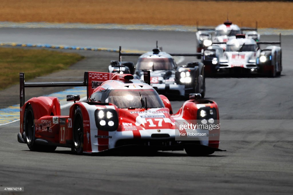The Porsche Team 919 Hybrid of Mark Webber Brendon Hartley and Timo Bernhard drives during the Le Mans 24 Hour race at the Circuit de la Sarthe on...