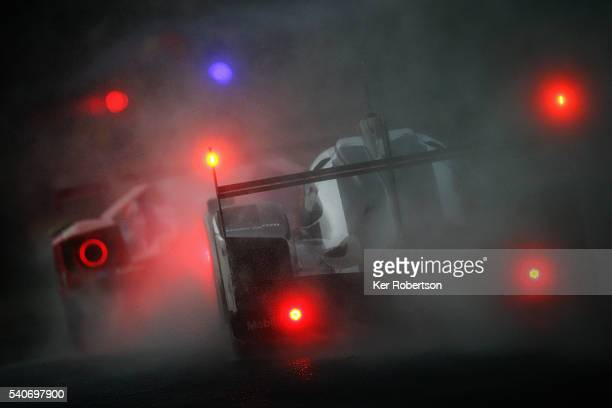 The Porsche Team 919 Hybrid of Mark Webber Brendon Hartley and Timo Bernhard drives during qualifying for the Le Mans 24 Hour race at the Circuit de...