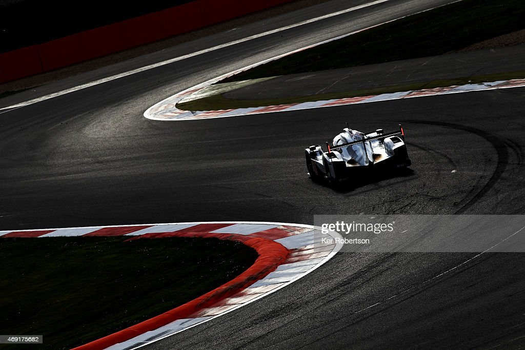 The Porsche Team 919 Hybrid of <a gi-track='captionPersonalityLinkClicked' href=/galleries/search?phrase=Mark+Webber+-+Race+Car+Driver&family=editorial&specificpeople=167271 ng-click='$event.stopPropagation()'>Mark Webber</a>, <a gi-track='captionPersonalityLinkClicked' href=/galleries/search?phrase=Timo+Bernhard&family=editorial&specificpeople=4194103 ng-click='$event.stopPropagation()'>Timo Bernhard</a> and <a gi-track='captionPersonalityLinkClicked' href=/galleries/search?phrase=Brendon+Hartley&family=editorial&specificpeople=4823179 ng-click='$event.stopPropagation()'>Brendon Hartley</a> drives during practice for the FIA World Endurance Championship 6 Hours of Silverstone at Silverstone Circuit on April 10, 2015 in Northampton, England.