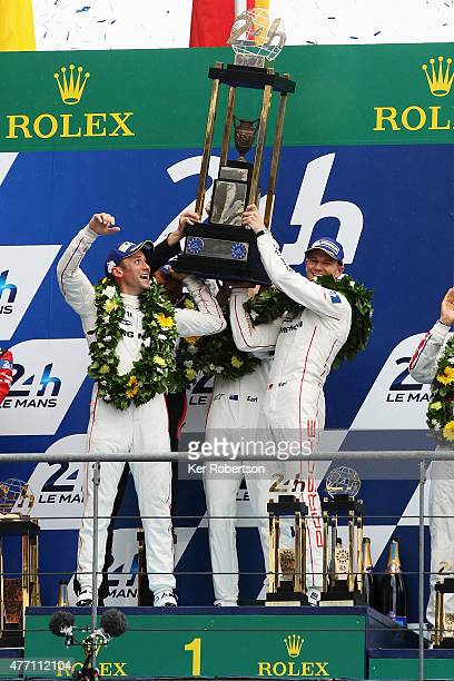 The Porsche Team 919 Hybrid of Nick Tandy of Great Britain Earl Bamber of New Zealand and Nico Hulkenburg of Germany celebrate on the podium after...