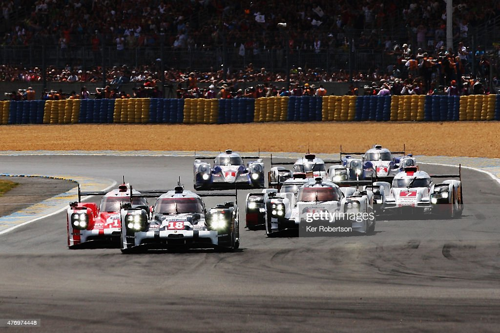 The Porsche Team 919 Hybrid of Romain Dumas Neel Jani and Marc Lieb leads from its sister car the Porsche Team 919 Hybrid driven by Mark Webber...