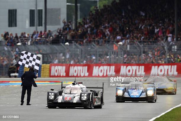 The Porsche Team 919 of Neel Jani Romain Dumas and Marc Lieb crosses the finish line to win the Le Mans 24 Hour race at the Circuit de la Sarthe on...