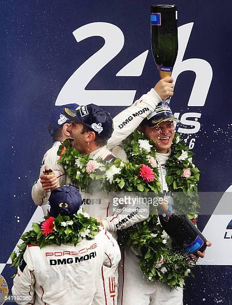 The Porsche Team 919 of Neel Jani Romain Dumas and Marc Lieb celebrates on the podium after winning the Le Mans 24 Hour race at the Circuit de la...