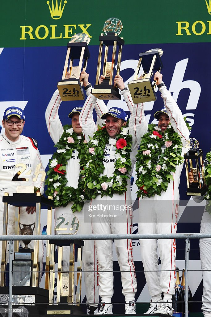 The Porsche Team 919 of <a gi-track='captionPersonalityLinkClicked' href=/galleries/search?phrase=Neel+Jani&family=editorial&specificpeople=541892 ng-click='$event.stopPropagation()'>Neel Jani</a> (right), <a gi-track='captionPersonalityLinkClicked' href=/galleries/search?phrase=Romain+Dumas&family=editorial&specificpeople=805197 ng-click='$event.stopPropagation()'>Romain Dumas</a> (centre) and <a gi-track='captionPersonalityLinkClicked' href=/galleries/search?phrase=Marc+Lieb&family=editorial&specificpeople=3199675 ng-click='$event.stopPropagation()'>Marc Lieb</a> (left) celebrates on the podium after winning the Le Mans 24 Hour race at the Circuit de la Sarthe on June 19, 2016 in Le Mans, France.