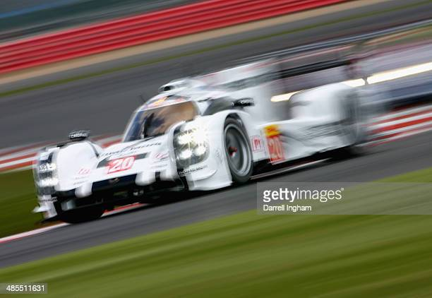 The Porsche Team Porsche 919 Hybrid LMP1 driven by Mark Webber of Australia Timo Bernhard of Germany and Brendan Hartley of New Zealand during...