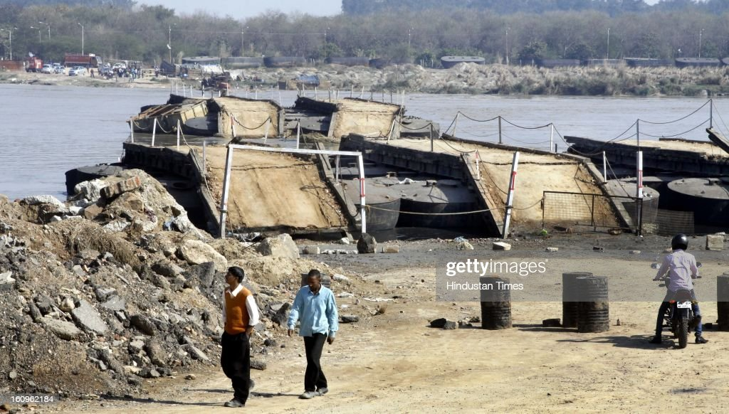 The portion of Temporary Pantoon Bridge remains as rest of the bridge was swayed away by the water released suddenly from the Hathni Kund Bairaj ,Harayna, Near Wazirabad Bridge on February 8, 2013 in New Delhi, India.