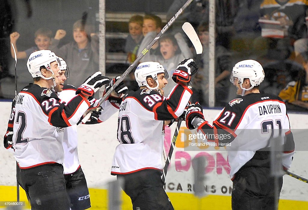 The Portland Pirates celebrate their second goal of the game as the Portland Pirates host the Providence Bruins in AHL playoff action at the Cross Insurance Arena. #22 is Phil Lane, #38 is <a gi-track='captionPersonalityLinkClicked' href=/galleries/search?phrase=Lucas+Lessio&family=editorial&specificpeople=7336111 ng-click='$event.stopPropagation()'>Lucas Lessio</a>, and #21 is <a gi-track='captionPersonalityLinkClicked' href=/galleries/search?phrase=Laurent+Dauphin&family=editorial&specificpeople=10122405 ng-click='$event.stopPropagation()'>Laurent Dauphin</a>.