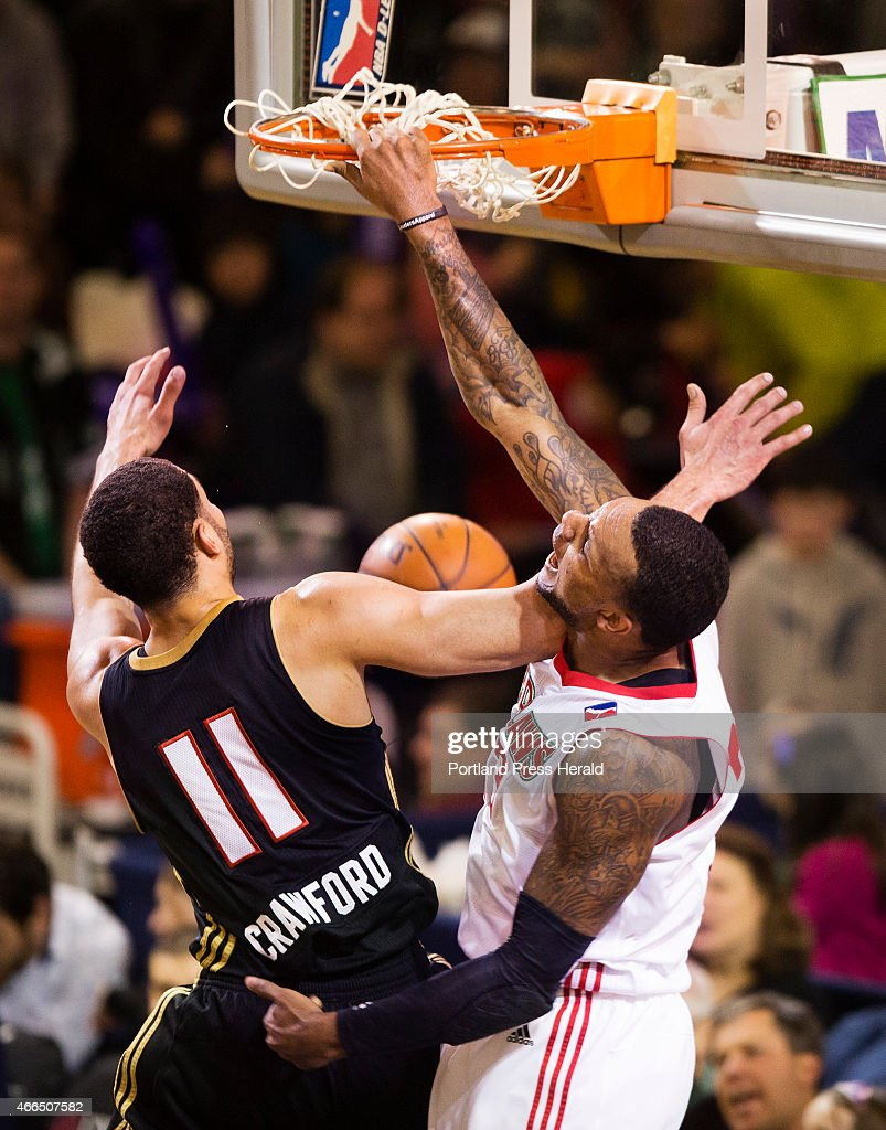 The Portland Red Claws forward Romero Osby dunks the ball against Erie Bayhawks forward Drew Crawford during D League action at the Expo in Portland on Sunday, March 15.