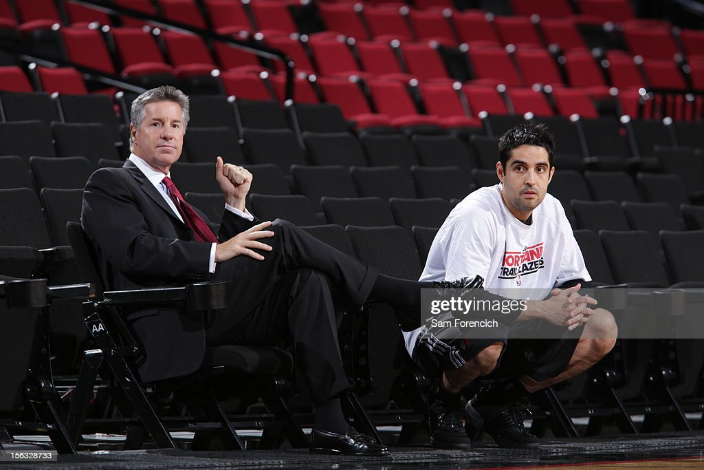 The Portland Trail Blazer General Manager <a gi-track='captionPersonalityLinkClicked' href=/galleries/search?phrase=Neil+Olshey&family=editorial&specificpeople=2214642 ng-click='$event.stopPropagation()'>Neil Olshey</a> and assistant coach Kaleb Canales before the game against the Los Angeles Clippers on November 8, 2012 at the Rose Garden Arena in Portland, Oregon.