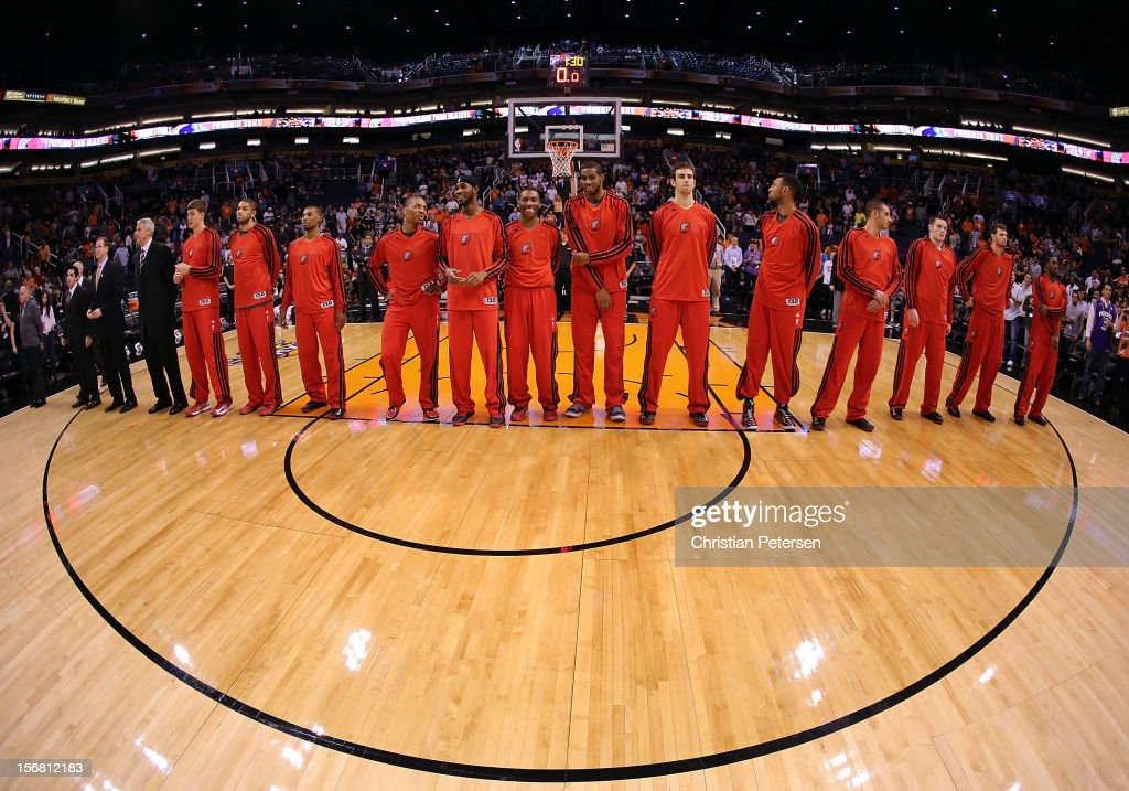 The Portland Trail Blazers line up for the National Anthem before the NBA game against the Phoenix Suns at US Airways Center on November 21, 2012 in Phoenix, Arizona.