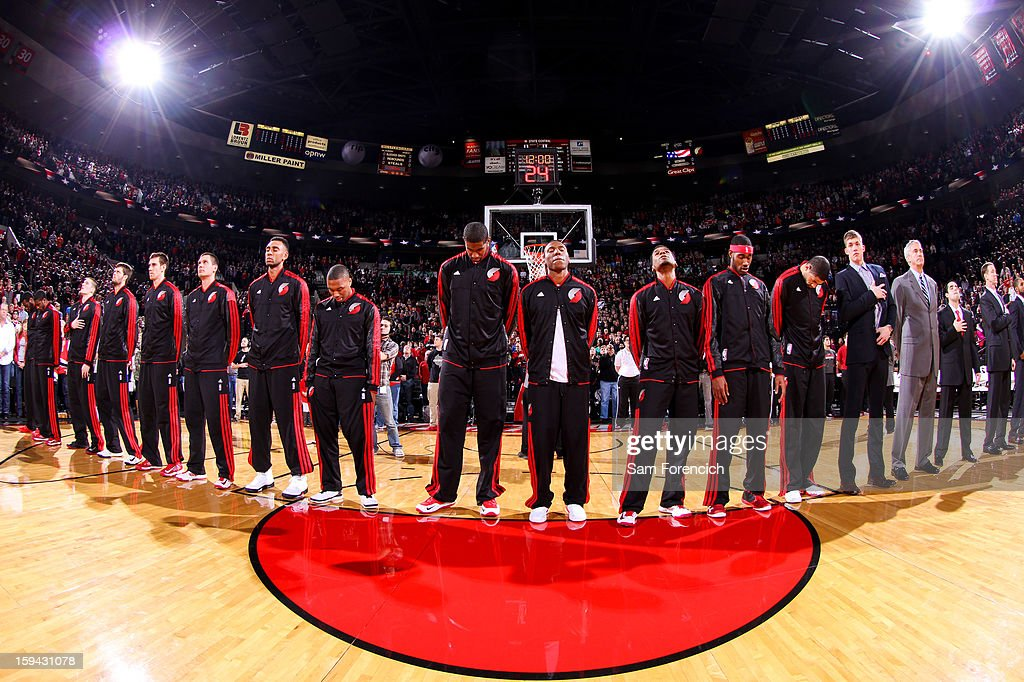 The Portland Trail Blazers listen to the National Anthem before playing against the Oklahoma City Thunder on January 13, 2013 at the Rose Garden Arena in Portland, Oregon.