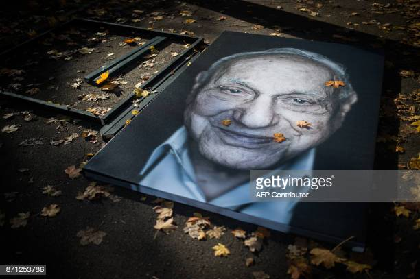 The portrait of a Holocaust survivor by photographer and filmmaker Luigi Toscano lays on the ground as it is made ready to be fixed during a preview...