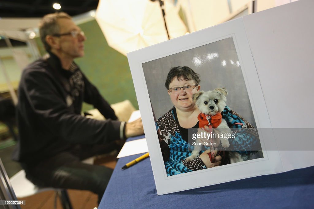 The portrait of a woman with her dog stands on display at the stand of a photographer who specializes in photographing owners and their pets at the pet trade fair (Heimtiermesse) at Velodrom on November 2, 2012 in Berlin, Germany. Exhibitors are showing the latest trends in collars, snacks and other accessories for cats, dogs and other household pets.