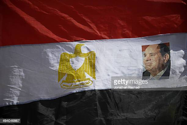 The portrait of candidate Abdel Fattah alSisi placed on a flag being sold by street vendors outside a polling station in the Cairo suburb of Imbaba...