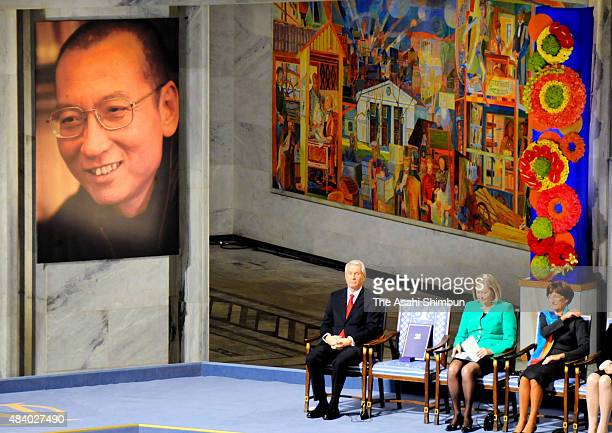 The portrait of Chinese activist Liu Xiaobo is displayed while the Nobel Peace Prize medal and certificate are place on the empty chair during the...