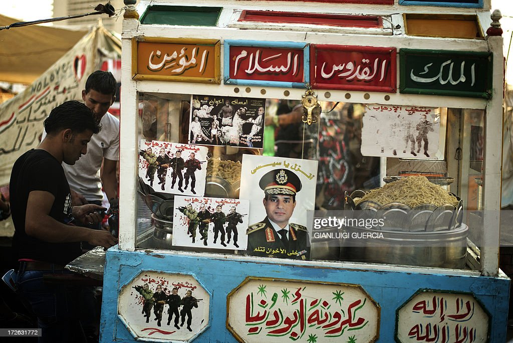 The portrait of Egyptian Defence Minister Abdelfatah al-Sisi is seen on a street vendors cart in Egypt's landmark Tahrir square on July 4, 2013. Egypt's Muslim Brotherhood, from which ousted president Mohamed Morsi hails, denounced a new 'police state' after the arrest of Islamist leaders and the closure of satellite channels.