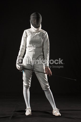 The Portrait Of Woman Wearing White Fencing Costume On ...