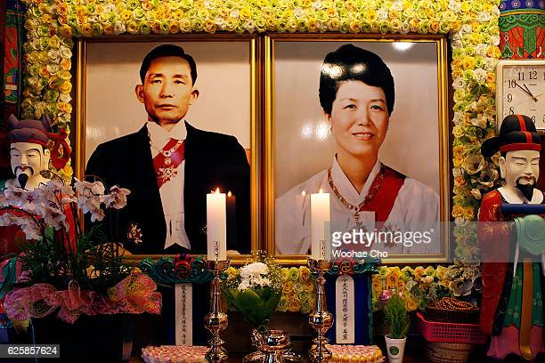 The portraits of former president Park Chunghee and his wife Yuk Youngsoo president Park Geunhye's parents are exhibited in the temple on November 26...
