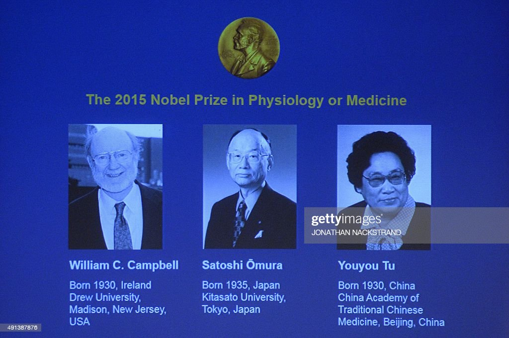 The portraits of the winners of the Nobel Medicine Prize 2015 Irishborn William Campbell Satoshi Omura of Japan and China's Youyou Tu are displayed...