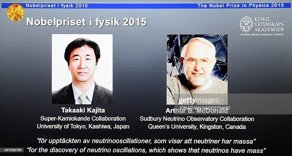 The portraits of the winners of the Nobel Prize in Physics 2015 Takaaki Kajita and Arthur B McDonald are displayed on a screen during a press...