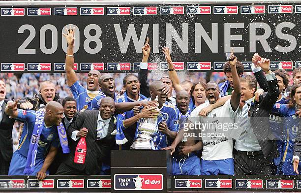 The Portsmouth team celebrate with the FA Cup trophy after their FA Cup final match against Cardiff City at Wembley football Stadium London on May 17...