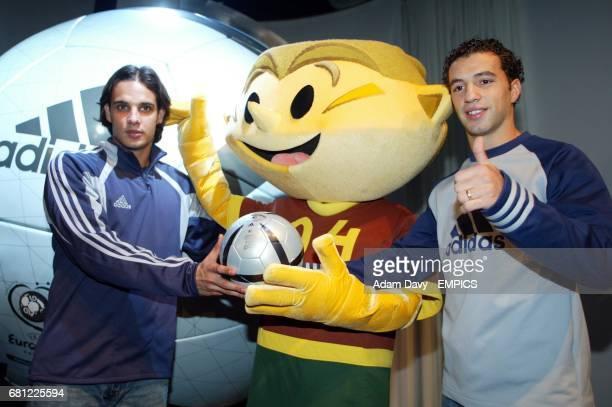The Portugal mascot for the Euro 2004 Championships Kinas with players Nuno Gomes and Simao Sabrosa and the new Adidas matchball