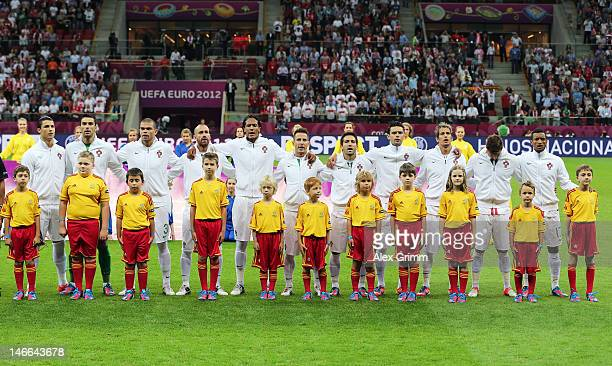 The Portugal team line up with player escorts ahead of the UEFA EURO 2012 quarter final match between Czech Republic and Portugal at The National...