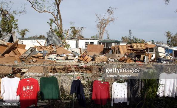 The possessions of Tod Farrington and with his wife Jennifer Farrington hang in front of destroyed buildings in the wake of Hurricane Wilma on...
