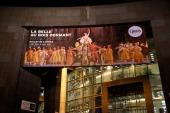 The poster of the ballet 'Sleeping Beauty' by Rudolf Nureev is seen on the facade of the Bastille Opera house following the 'Reves d'Enfants' Arop...