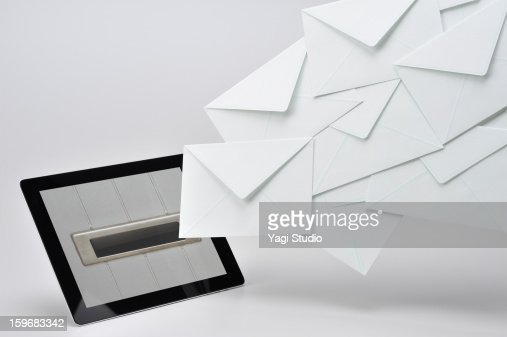 The posting email on the tablet : Stock Photo
