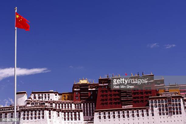 CONTENT] The Potala Palace with the Chinese national flag