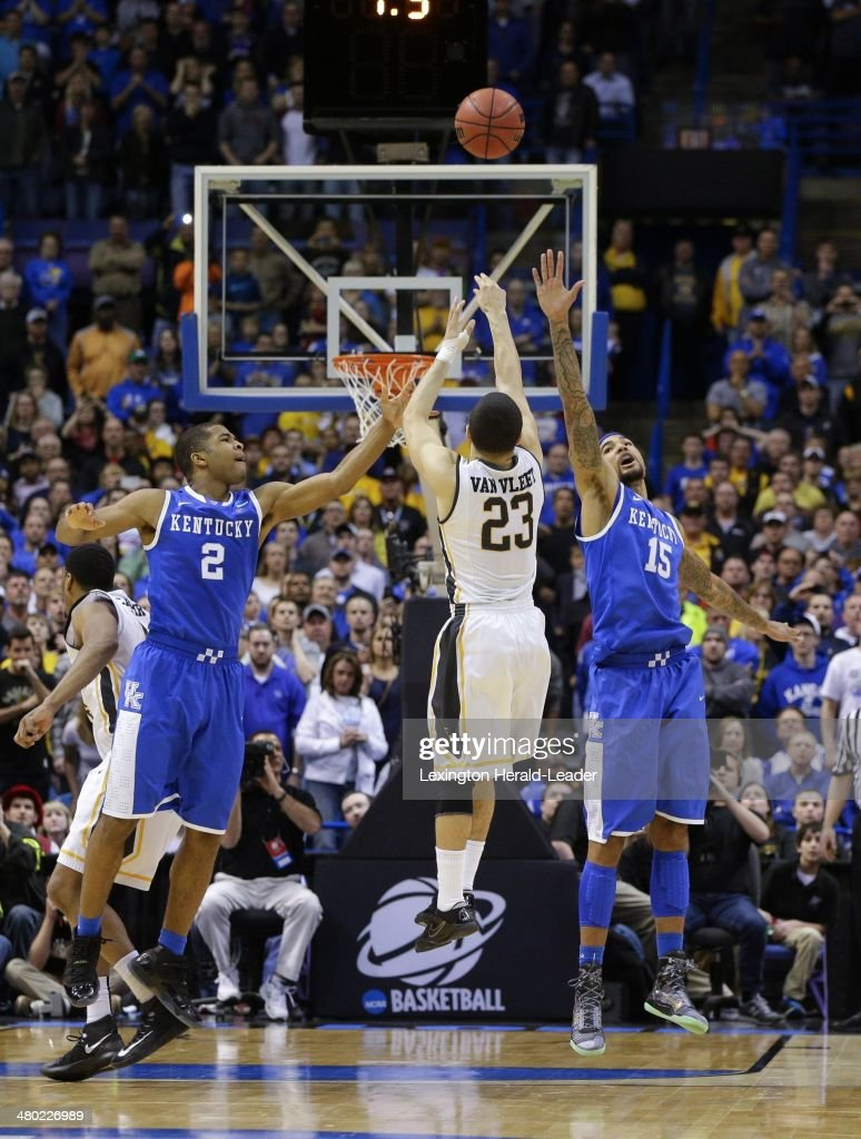 The potential gamewinning shot by Wichita State Shockers guard Fred VanVleet was off the mark as he was defended by Kentucky Wildcats guard Aaron...