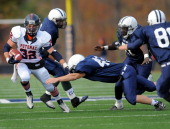 The Potomac School running back Conor McNerney eludes the tackles of the Flint Hill defense on his way to a first down during the game at the Potomac...