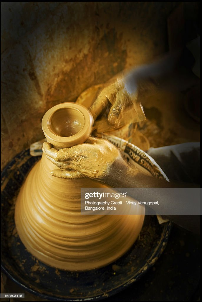 The Potter and his Clay : Stock Photo