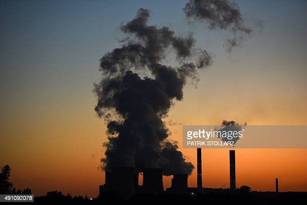 The power plant 'Weisweiler' run by brown coal from an open cast mine is pictured on October 2 2015 in Weisweiler western Germany AFP PHOTO / PATRIK...