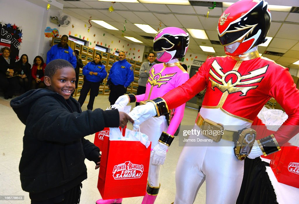 The Power Rangers deliver Thanksgiving gifts to families at HELP Bronx Morris Avenue on November 20, 2012 in New York City.