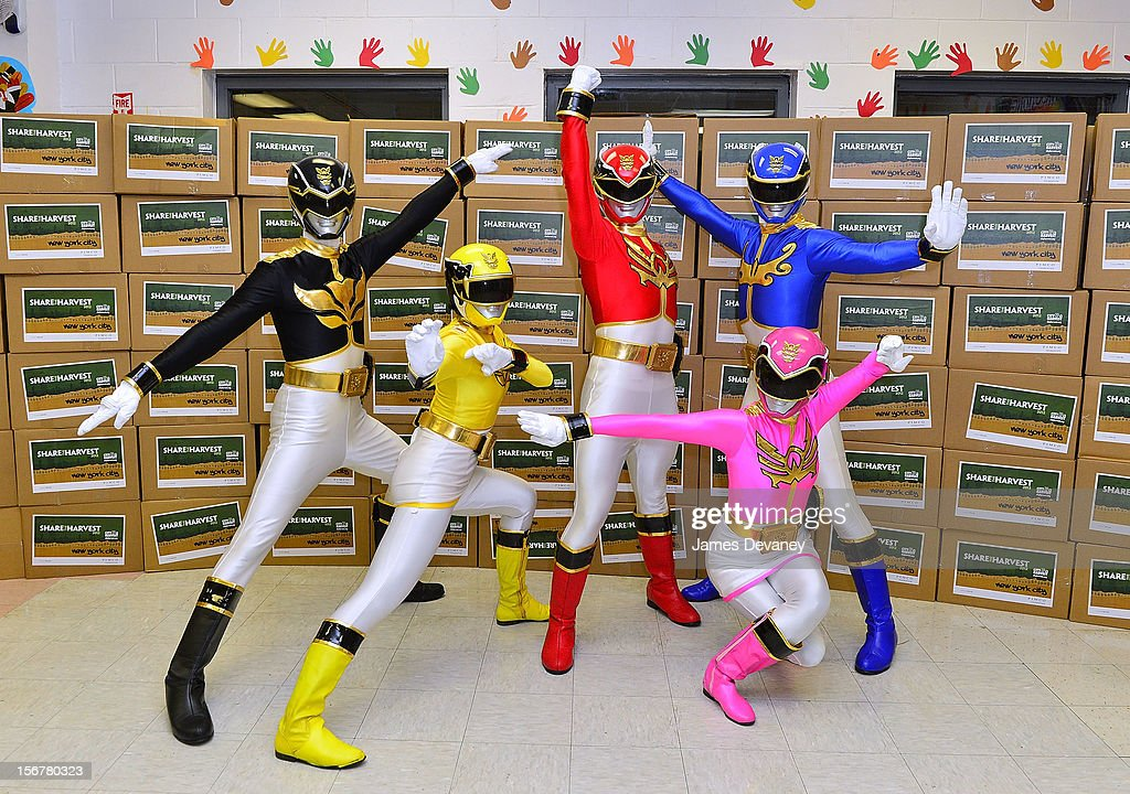 The Power Rangers deliver Thanksgiving gifts to families of Help USA Shelter at HELP Bronx Morris Avenue on November 20, 2012 in New York City.