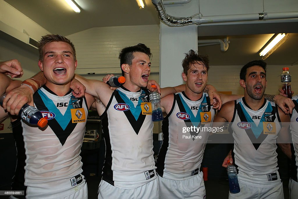 The Power sing their club song after winning the round five AFL match between the West Coast Eagles and the Port Power at Patersons Stadium on April 19, 2014 in Perth, Australia.
