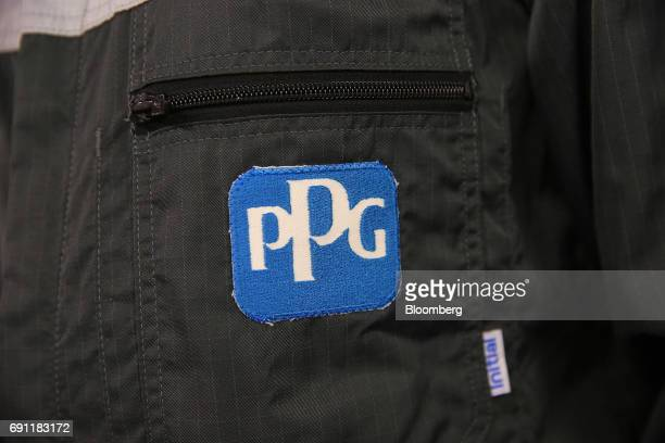The PPG Industries Inc logo sits on an employee's overalls at PPG Industries Inc's automotive coating's technical center in Ingersheim Germany on...