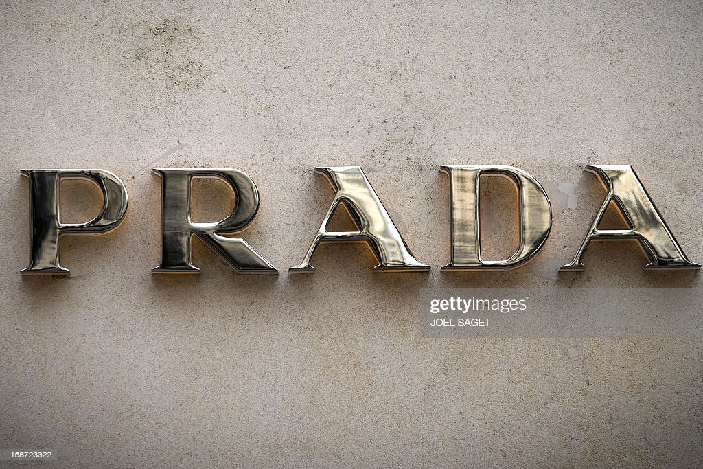 The Prada store name is pictured above the facade of a shop, on December 26, 2012 in Paris. AFP PHOTO / JOEL SAGET