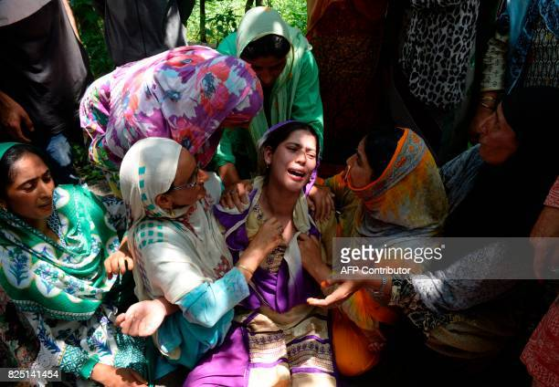 TOPSHOT The pregnant wife of Kashmiri civilian Firdous Ahmed mourns during his funeral at Begum Bagh Pulwama south of Srinagar on August 1 2017...