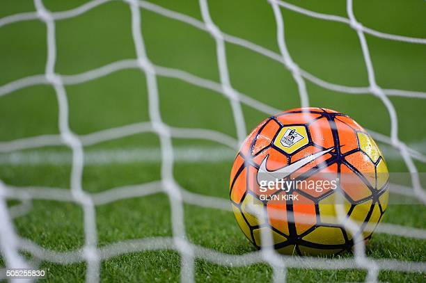 The Premier League and Nike logos are seen on a football behind the net of a goal ahead of the English Premier League football match between Aston...