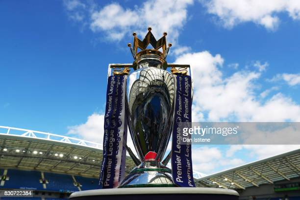 The Premier League trophy is displayed inside the stadium before the Premier League match between Brighton and Hove Albion and Manchester City at...