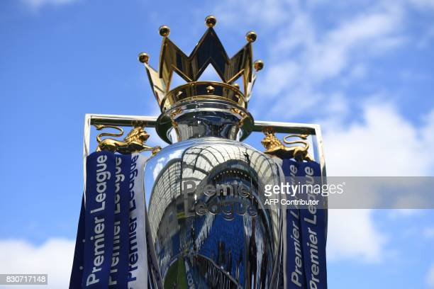 The Premier league trophy is pictured beneath the blue sky ahead of the English Premier League football match between Brighton and Hove Albion and...