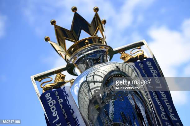 TOPSHOT The Premier league trophy is pictured beneath the blue sky ahead of the English Premier League football match between Brighton and Hove...